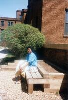 An unidentified A Black person posing for a picture outside of Memorial Hall, 1990