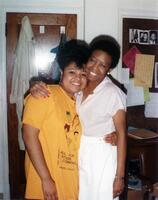 A Black person and M. Anita Hawthorne taking a picture together, 1990