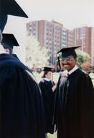 Augsburg graduates, including the A Black person smiling on the side, 1990