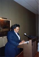 A Black person speaking, 1990