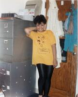 A Black person Union member posing in Office of Black Student Affairs, 1990