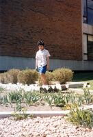 A Student posing for a picture outside the Christensen Center, 1990