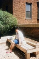 Student sitting outside of Memorial Hall, 1990