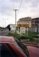 A building and signs in Nigeria, 1990