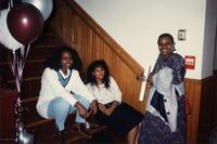 A picture of three unidentified Black women smiling, 1990