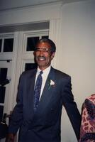 An unidentified Black man smiling after speaking at an event, 1992