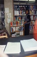 An unidentified Black woman smiling at Sverdrup Library 1996