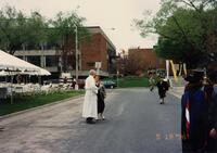 A group of unidentified people by the street of Murphy Square, 1996