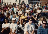 A group of unidentified Black people and others sitting in bleachers, 1992