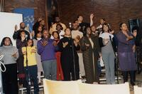 A group of unidentified Black people singing together inside Hoversten Chapel, 1996