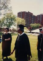 An unidentified Black woman walking through Murphy Square at a Graduation ceremony, 1993