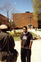 An unidentified man posing for a picture in the Quad, 1998