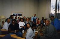 Brother Joe Young and Trena Bolden Fields pose with a group of unidentified Black people and others, 1998