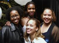Trena Bolden Fields poses with unidentified Black women and others at an event, circa 2005