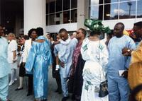 A group of Black people standing outside, circa 1997