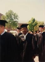 A Black graduate walking in the graduate procession, circa 1997