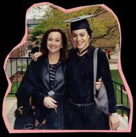 Yara Saade poses for a photograph with her mother during Commencement, circa 2003