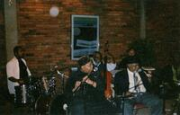 A Black jazz band performs, 2003
