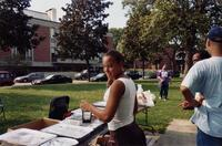 An unidentified Black woman setting up a table at Murphy Square, 2006