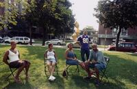 Five unidentified people sitting in Murphy Square, 2005