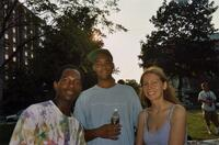 An unidentified Black man posing next to two unidentified people in Murphy Square, 2005
