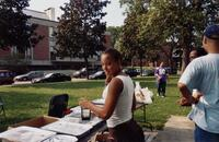 An unidentified Black woman setting up a table for a Pan-Afrikan BBQ, 2005