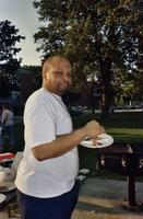 An unidentified man eating during a BBQ in Murphy Square, 2005