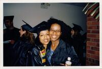 A Black graduate taking a picture with Trena Bolden Fields, 1995