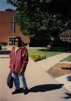 An unidentified Black person poses for a photograph in the quad, circa 1995
