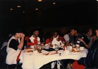 A group of Black people at a table, circa 1995