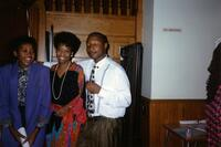 M. Anita Gay Hawthorne and two unidentified Black people posing and smiling, 1990