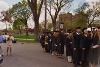Graduating seniors walk past Murphy Square at the commencement ceremony, 2004