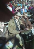 A person playing the drums in the bleachers, circa 1990