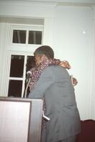 Two unidentified Black people hugging, 1995