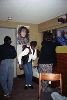 An unidentified Black person dancing while others stand around, circa 1990