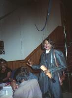 An unidentified Black person smiling for a photograph in Old Main, circa 1990