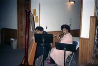 Two unidentified Black people performing music, circa 1990