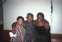 Anita Gay Hawthorne posing for a photograph with two Black people, circa 1990