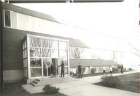 Sverdrup Hall, south entrance, facing northeast from west of Quad, circa 1955.