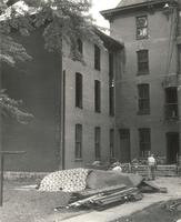 Old Main (1872-1948), demolition, west and center wings, facing northwest, 1948.