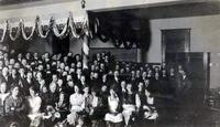 Men and women in Old Main (1902-) at Augsburg Seminary, circa 1902.