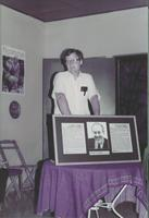 Joel Mugge standing in front of a memorial poster of James Mayer.