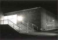 Si Melby Hall, north entrance at night, facing southeast, circa 1962.