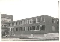 Sverdrup Hall, construction of south entrance, facing northwest, 1954-1955.
