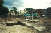 Lindell Library, construction site, facing east, 1996.