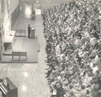 Si Melby Hall, gymnasium during chapel service, facing west, circa 1962.