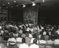 Si Melby Hall, gymnasium during chapel service, facing north, circa 1962.