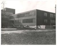 Sverdrup Hall, installation of south entrance, facing northwest, 1954-1955.