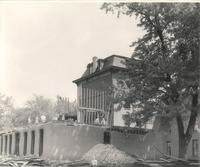 Old Main (1872-1948), demolition, southwest corner of west wing, facing northeast, 1948.